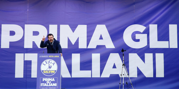 "Italian Northern League leader Matteo Salvini speaks during a political rally with a banner reading ""Italian first"" in the back, in Milan, Italy February 24, 2018.  REUTERS/Tony Gentile"